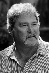 author Bruce Holbert profile image - Click to open Featured Narrator panel